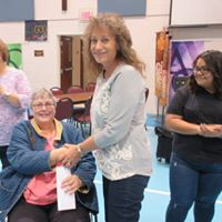 Diaper Depot's Dottie Bush gratefully receiving Rotary Club of Chambersburg's donation from Pam